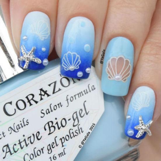 Дизайн ногтей в морском стиле - беспроигрышная тематика летнего маникюра